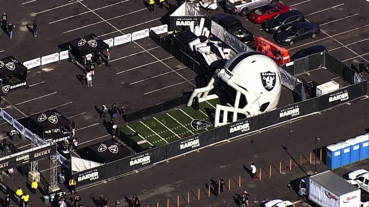 A giant inflatable Oakland Raiders helmet is seen in the parking lot of the Oakland Coliseum in Oakland, Calif. on Monday, September 10, 2018.