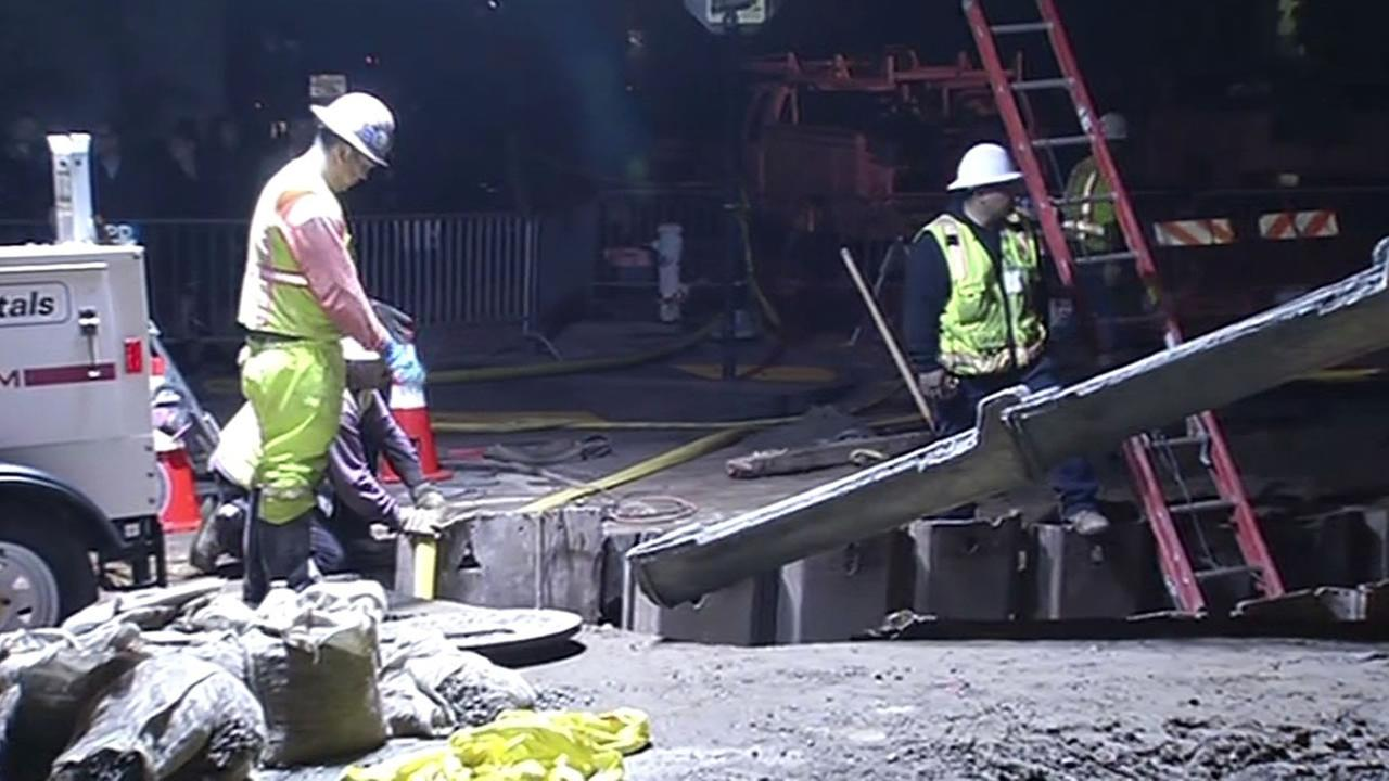 crews work to repair large sinkhole on Lake Street