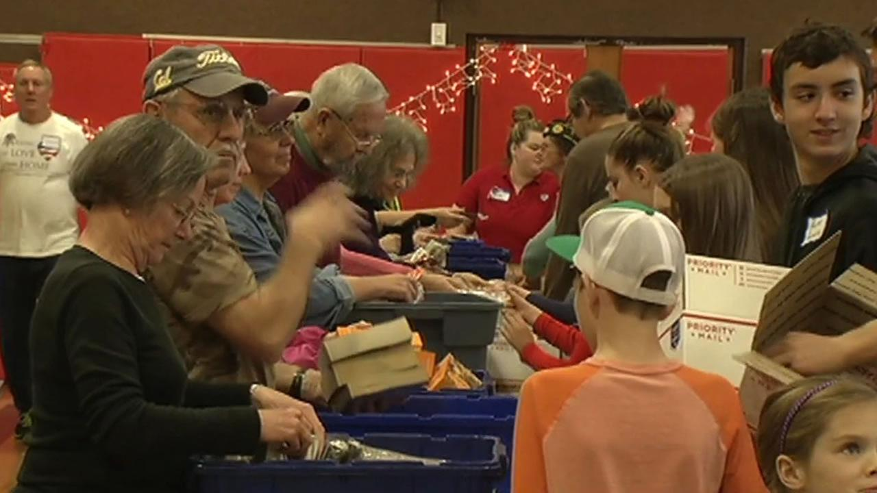 Hundreds of people dropped off donations Saturday for Operation With Love From Home.