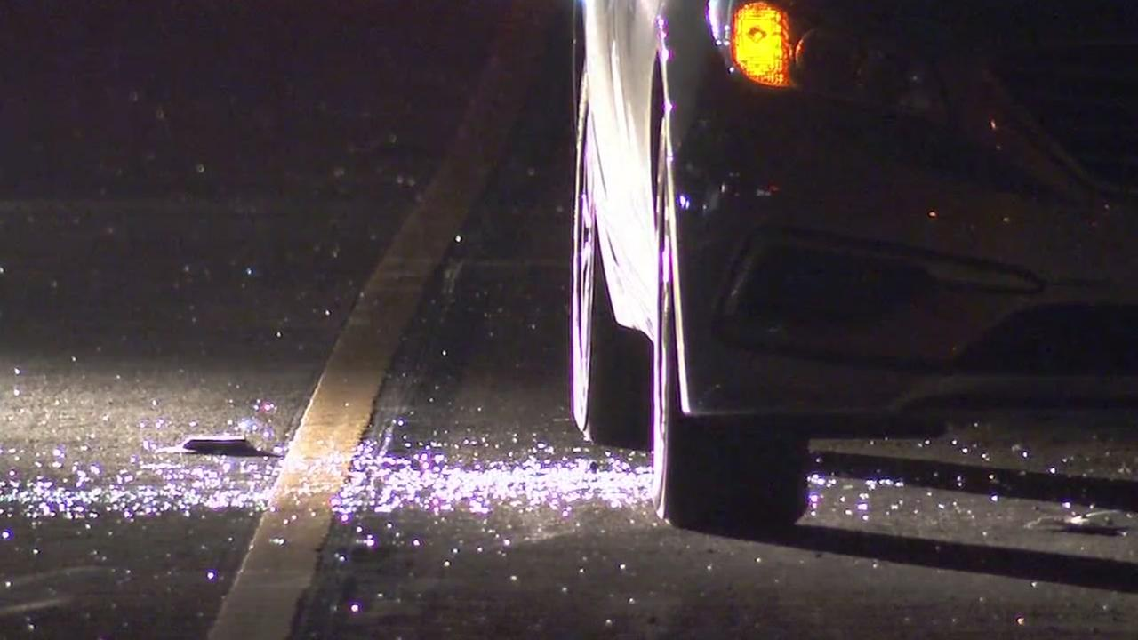 Shattered glass is seen after a shooting on I-980 in Oakland, Calif. on Friday, September 21, 2018.