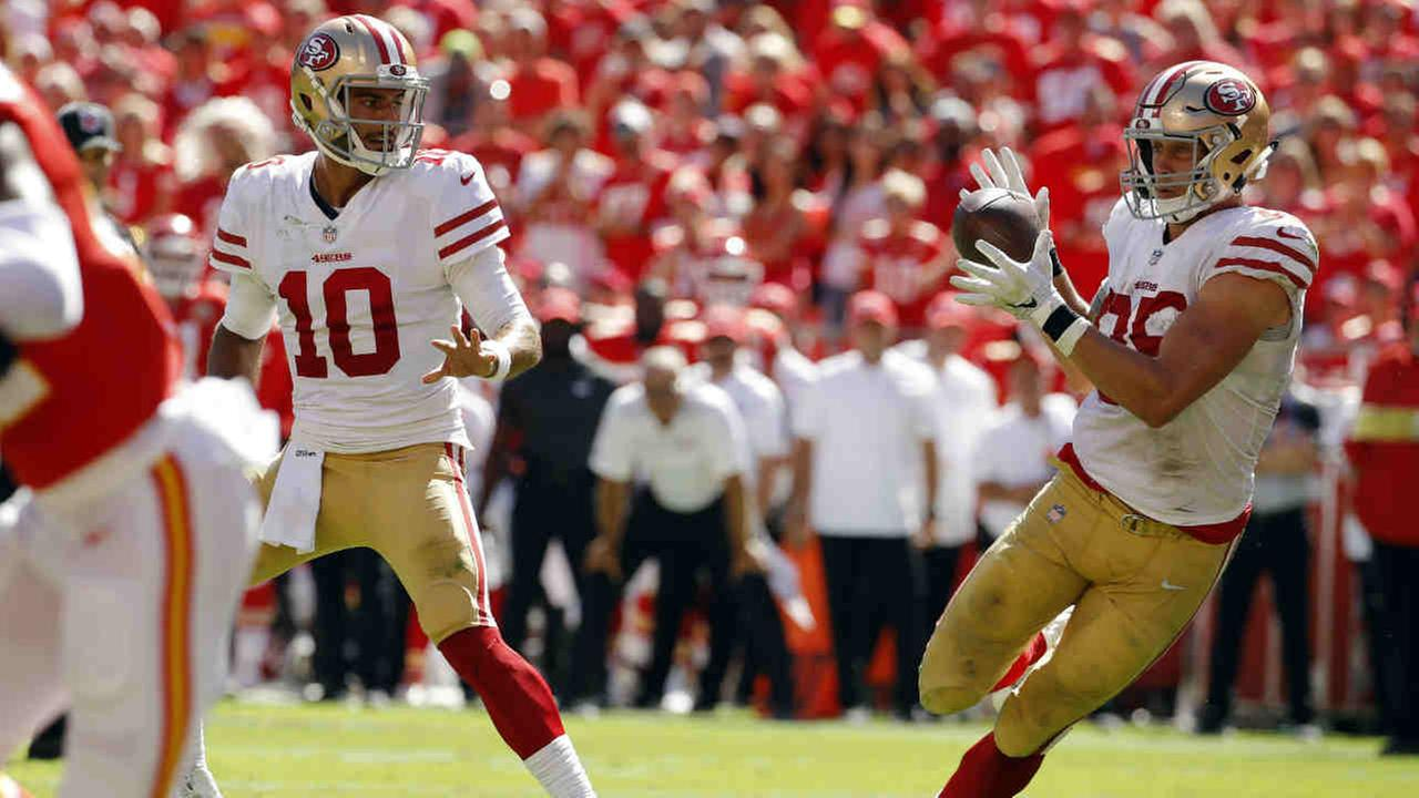 San Francisco 49er George Kittle (85) catches a pass from Jimmy Garoppolo (10) before a touchdown during an NFL football game against the Kansas City Chiefs on Sept. 23, 2018.
