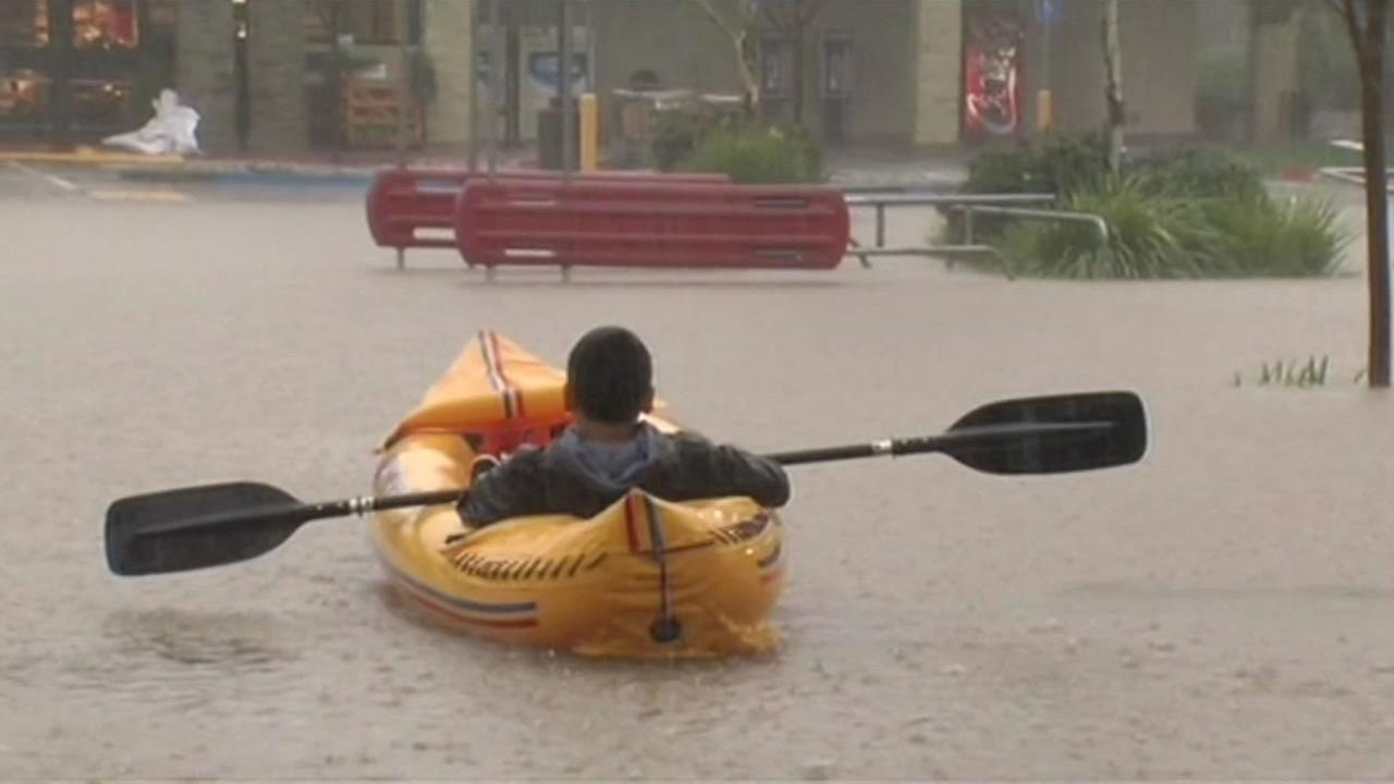 Some residents decided to kayak and canoe in a Safeway parking lot after it flooded in Healdsburg on Thursday, Dec. 11, 2014.