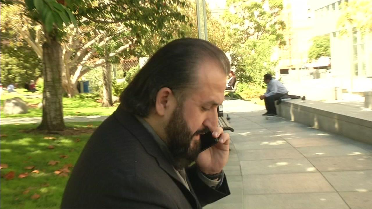 A man speaks on his Samsung phone in this undated image.