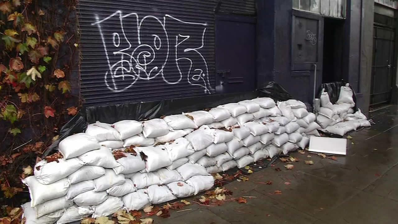 Residents in San Francisco prepare for the next round of rain on Monday, Dec. 15, 2014.