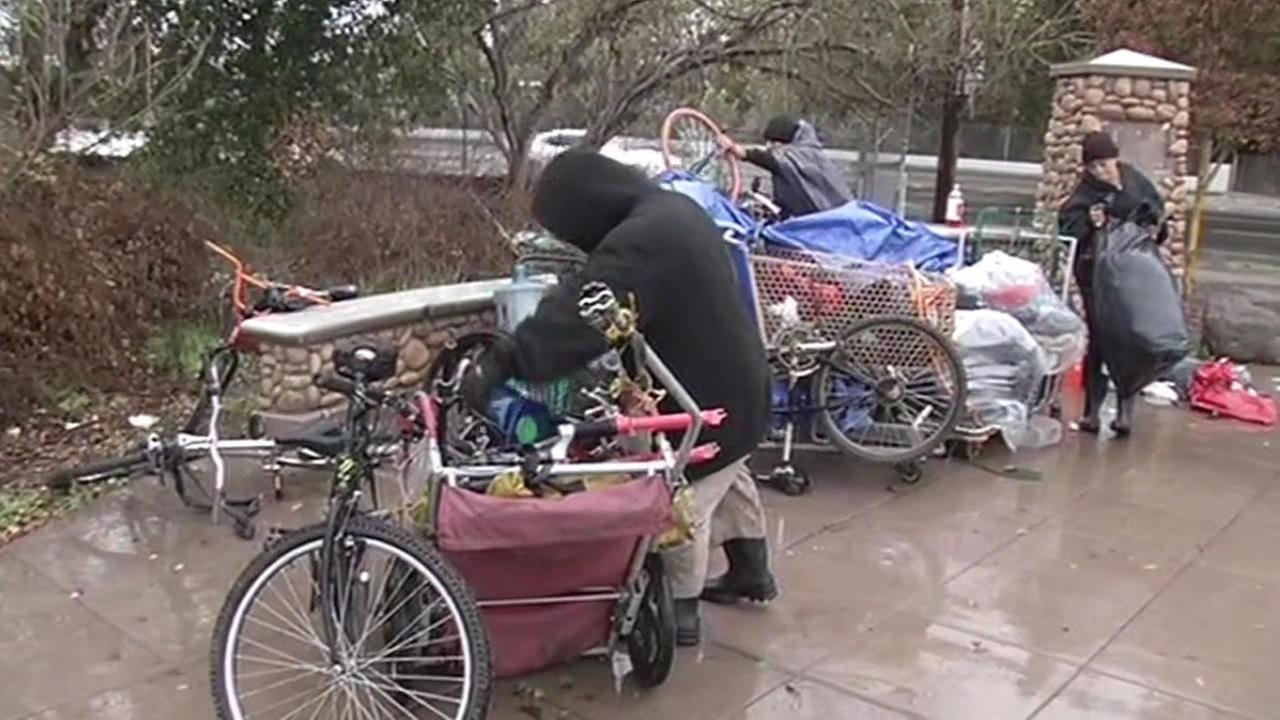 San Jose homeless gather their belongings