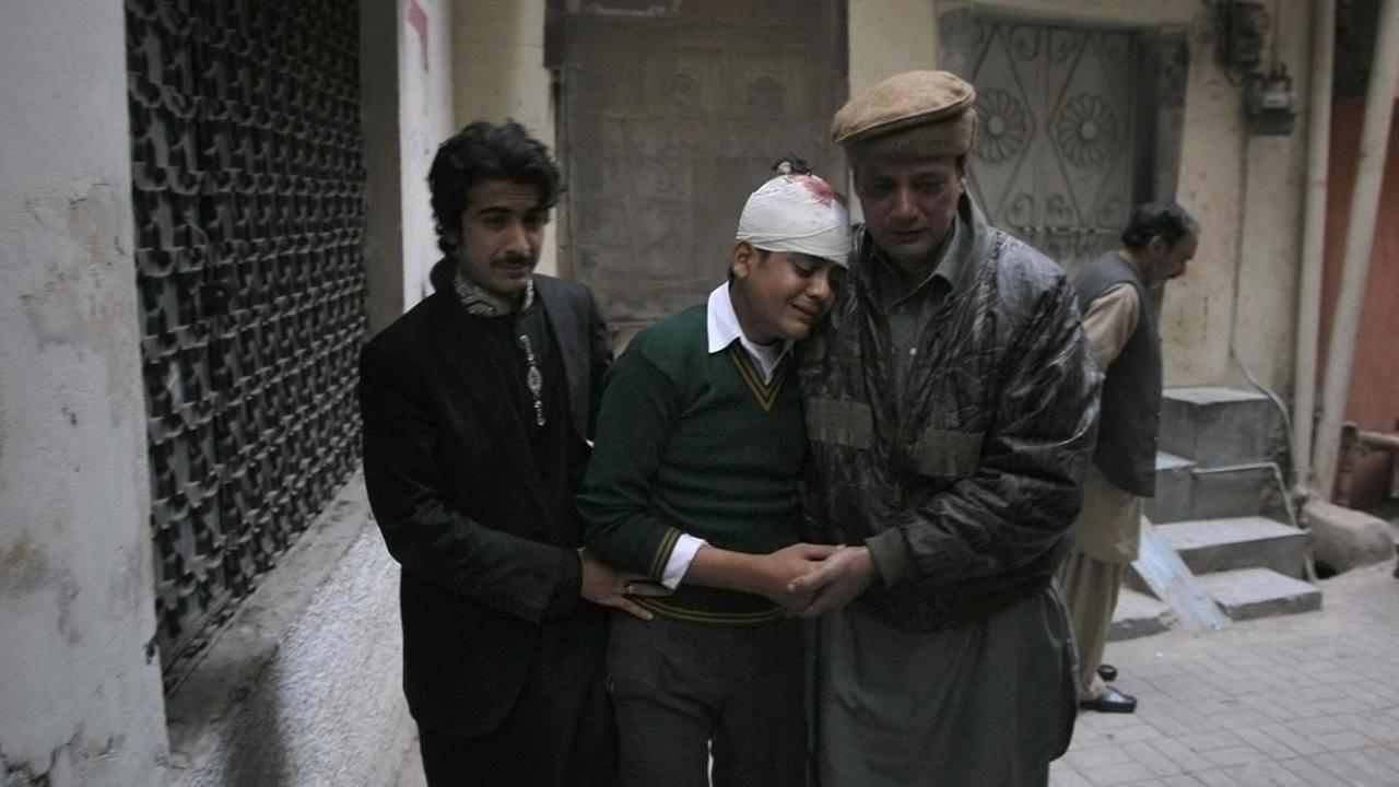 Injured student Mohammad Baqair, center, is comforted as he mourns the death of his mother who was a teacher at a school attacked by the Taliban, in Peshawar, Dec. 16, 2014. (AP Photo/Mohammad Sajjad)
