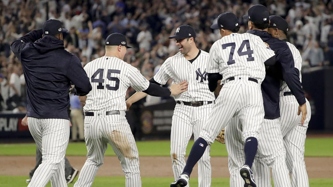 The New York Yankees celebrate after beating the Oakland Athletics 7-2 in the American League wild-card playoff baseball game, Wednesday, Oct. 3, 2018, in New York.