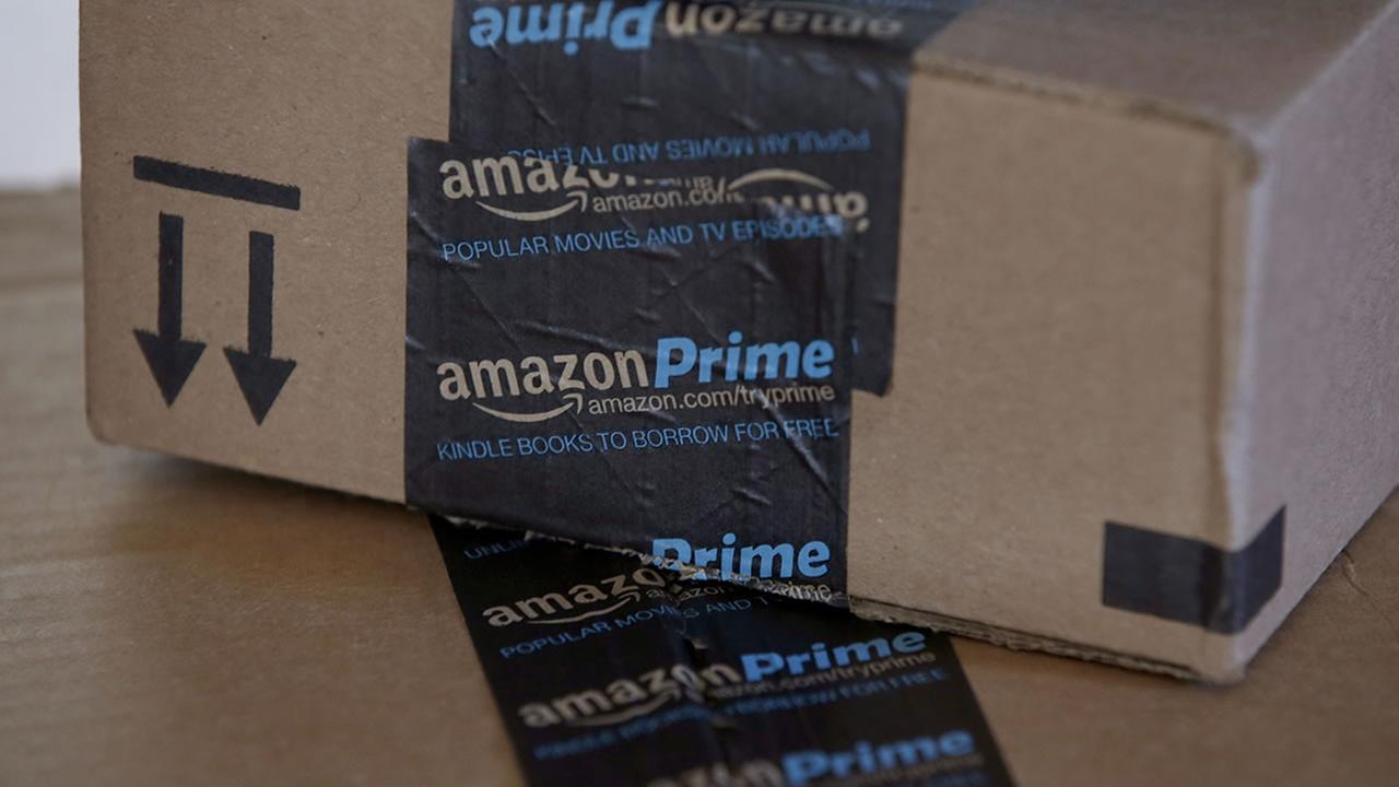This June 4, 2014 photo shows Amazon.com boxes in Phoenix. (AP Photo/Ross D. Franklin)