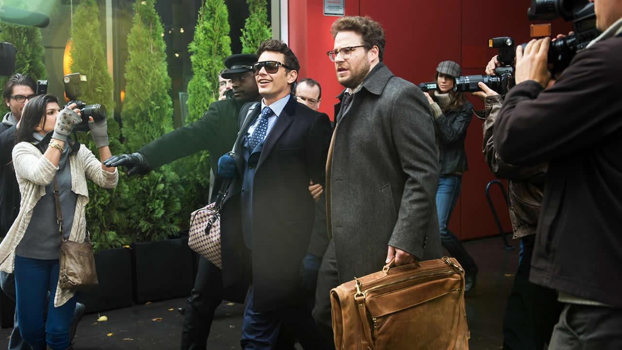 This photo provided by Columbia Pictures - Sony shows, James Franco, center left, as Dave, and Seth Rogen as Aaron, in The Interview. (AP Photo/Columbia Pictures - Sony, Ed Araquel)