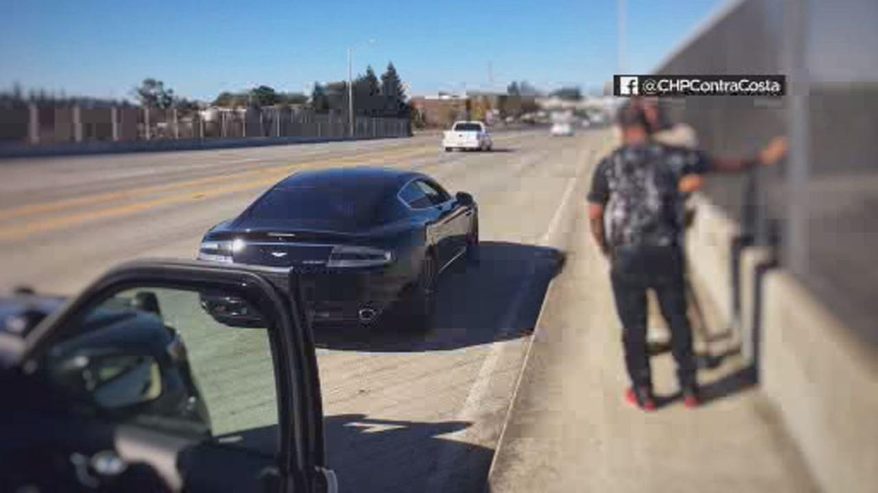 This image shows a CHP officer ticketing a driver in Contra Costa County on Oct.15