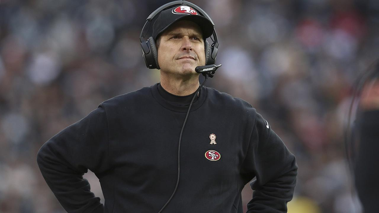 San Francisco 49ers head coach Jim Harbaugh stands on the sideline during the second half of an NFL football game against the Oakland Raiders in Oakland, Calif., Sunday, Dec. 7, 2014. The Raiders won 24-13. (AP Photo/Ryan Kang)