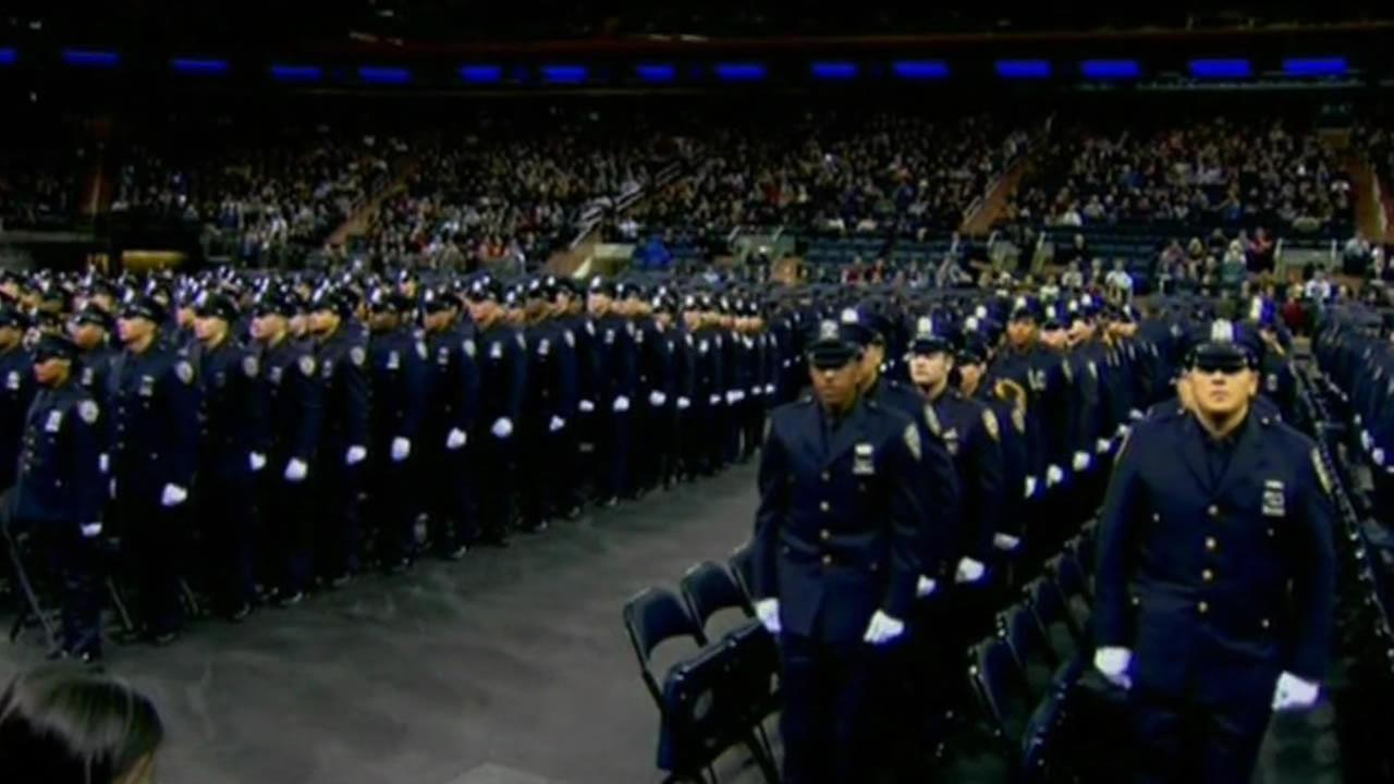 Officers stand at a New York Police Department graduation on Monday, Dec. 29, 2014.
