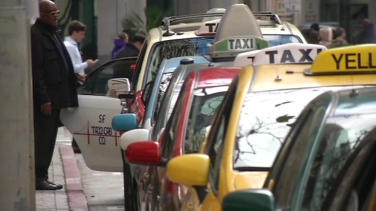 Taxicabs line up in San Francisco on Monday, Dec. 29, 2014.