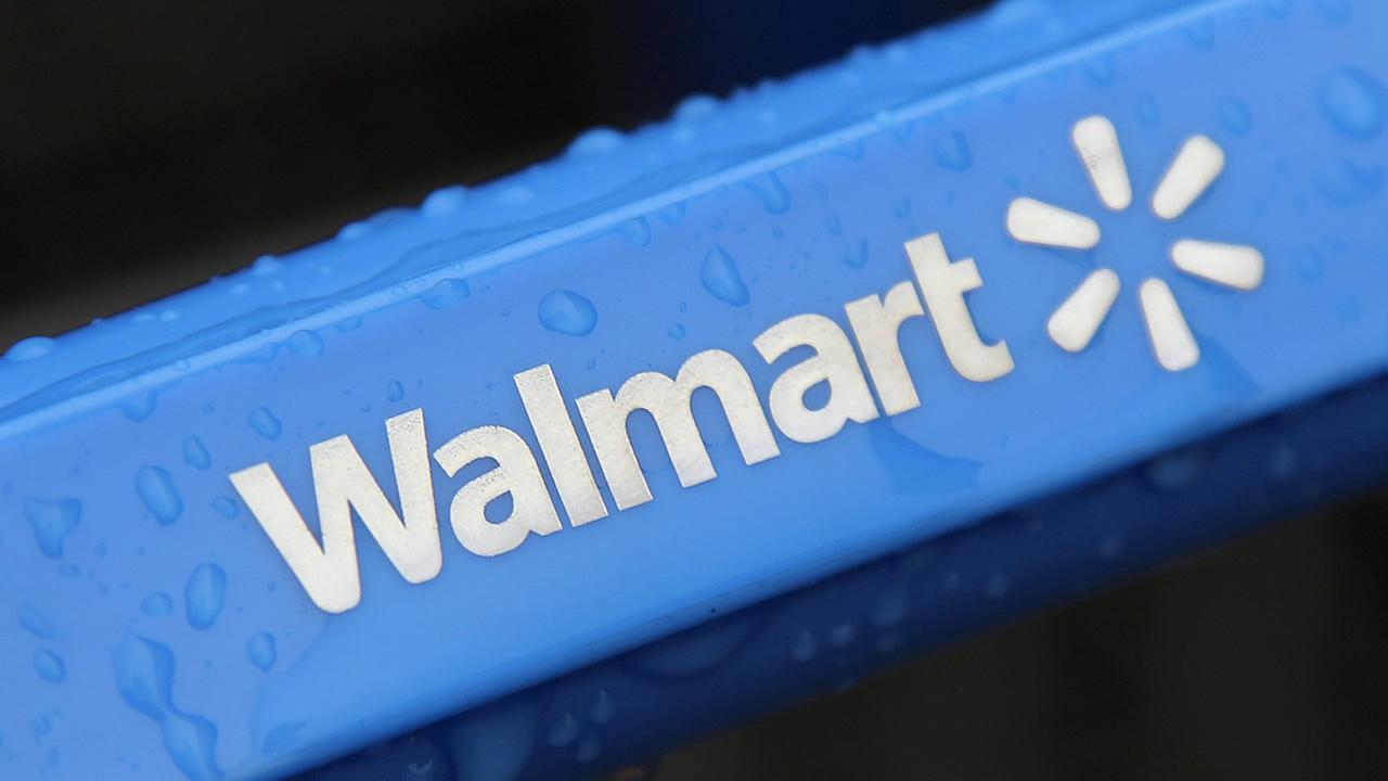This photo taken Nov. 14, 2011, shows the rain-soaked handle of a shopping cart outside the Wal-Mart store in Mayfield Hts. (AP Photo/Amy Sancetta, File)