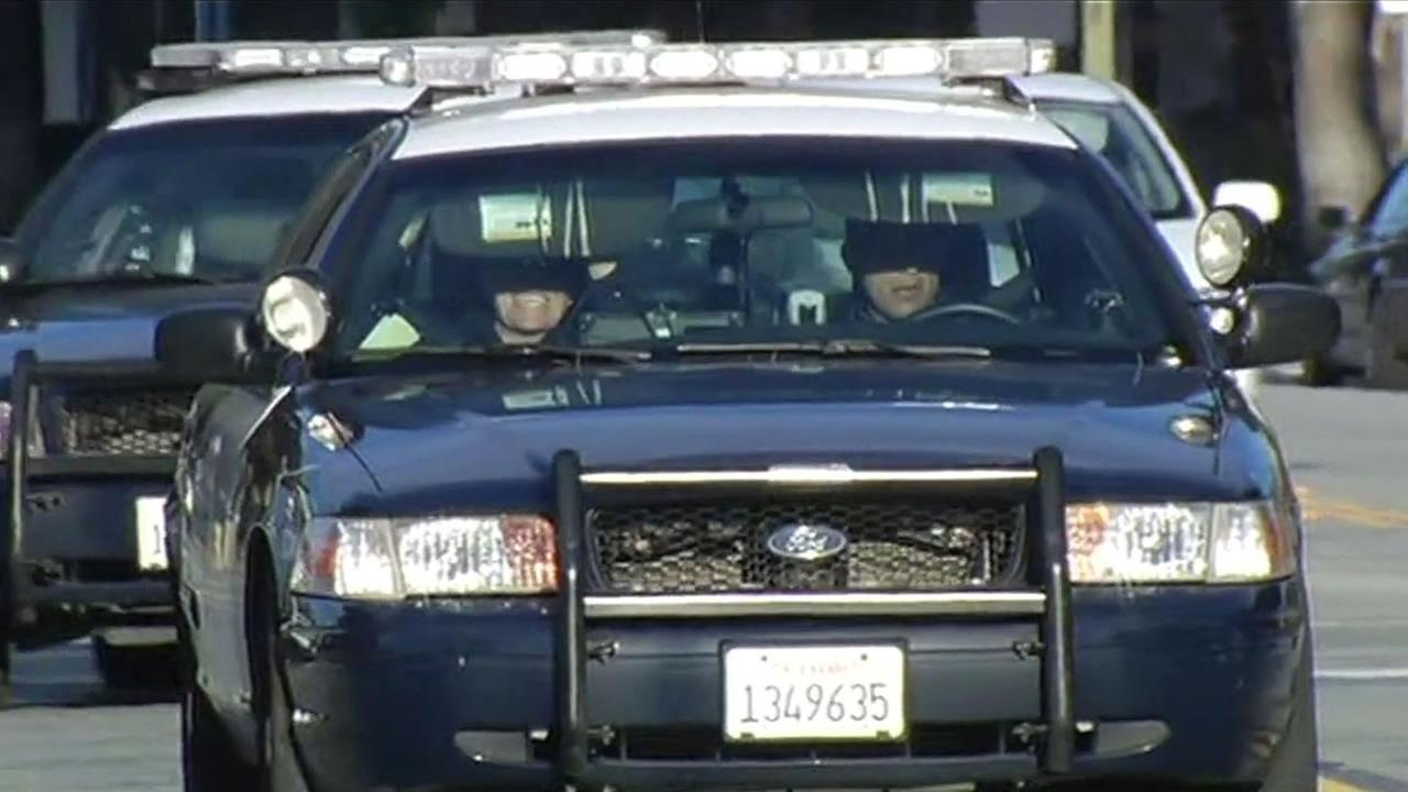 two officers in police cars