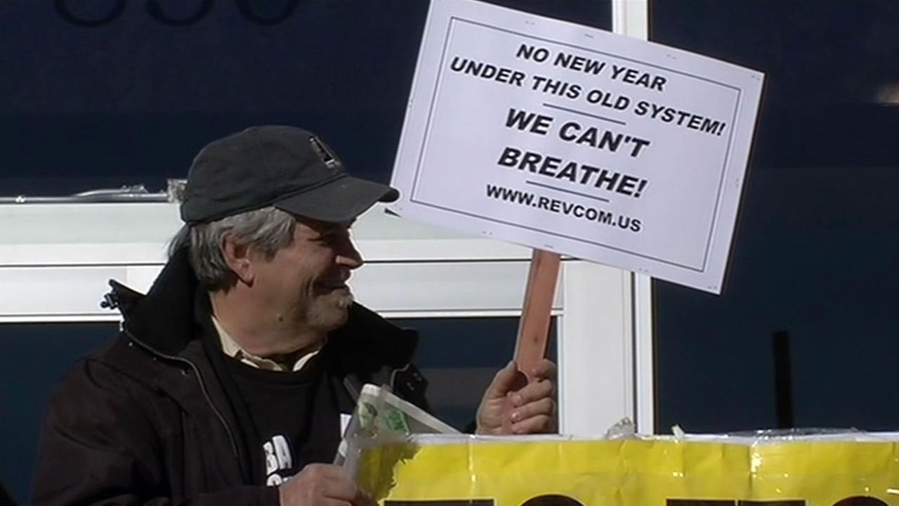 protester hold a sign