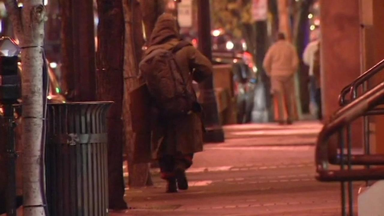 homeless person walks down the street in the North Bay