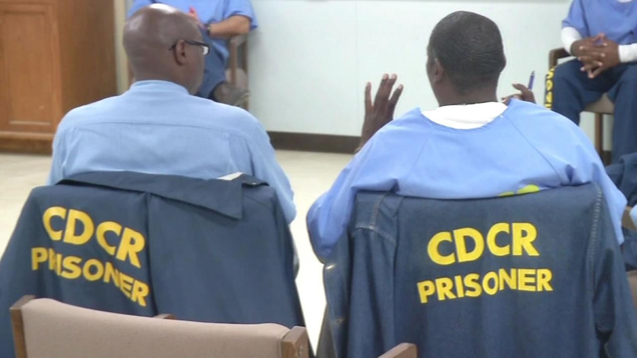 Two inmates at San Quentin prison sit side by side