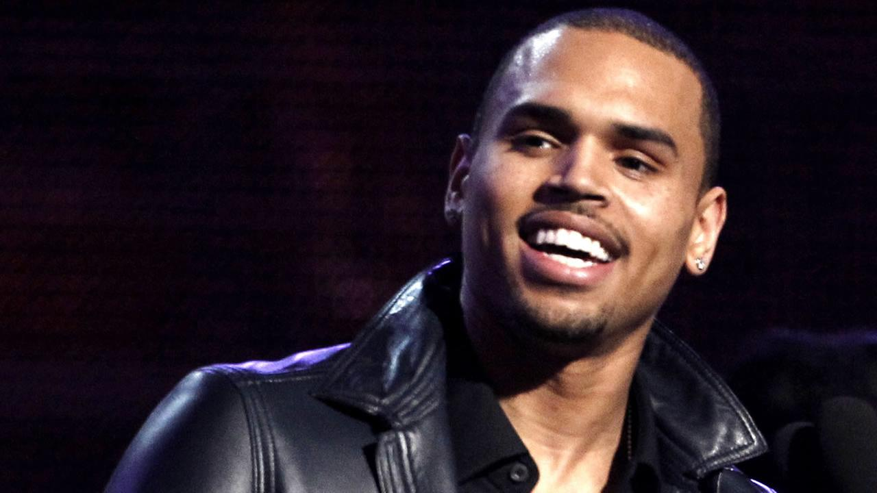Chris Brown accepts the award for best R&B album for F.A.M.E. during the 54th annual Grammy Awards on Sunday, Feb. 12, 2012 in Los Angeles. (AP Photo/Matt Sayles)
