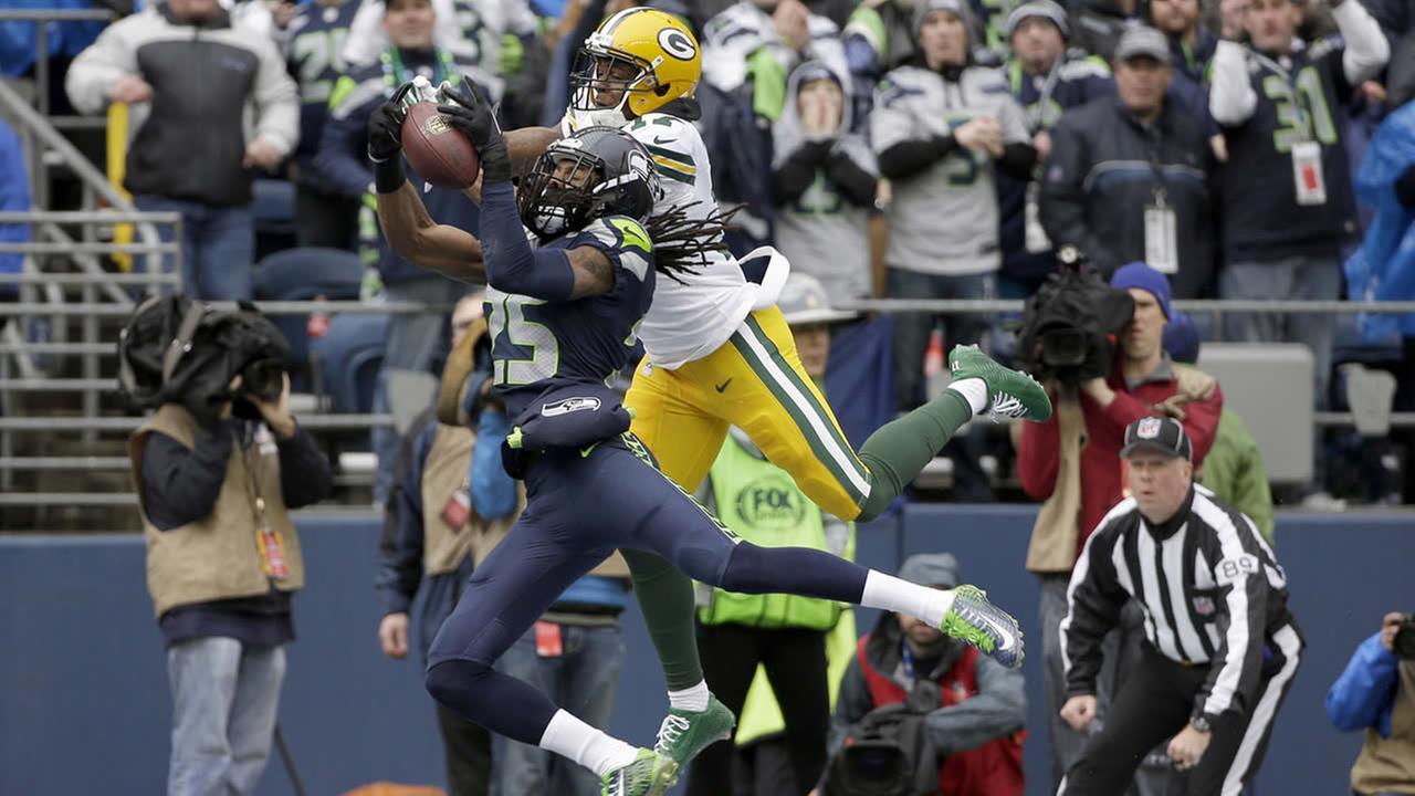 Seattle Seahawks cornerback Richard Sherman (25) intercepts a pass intended for Green Bay Packers wide receiver Davante Adams (17) on Jan. 18, 2015, in Seattle. (AP Photo/David J. Phillip)