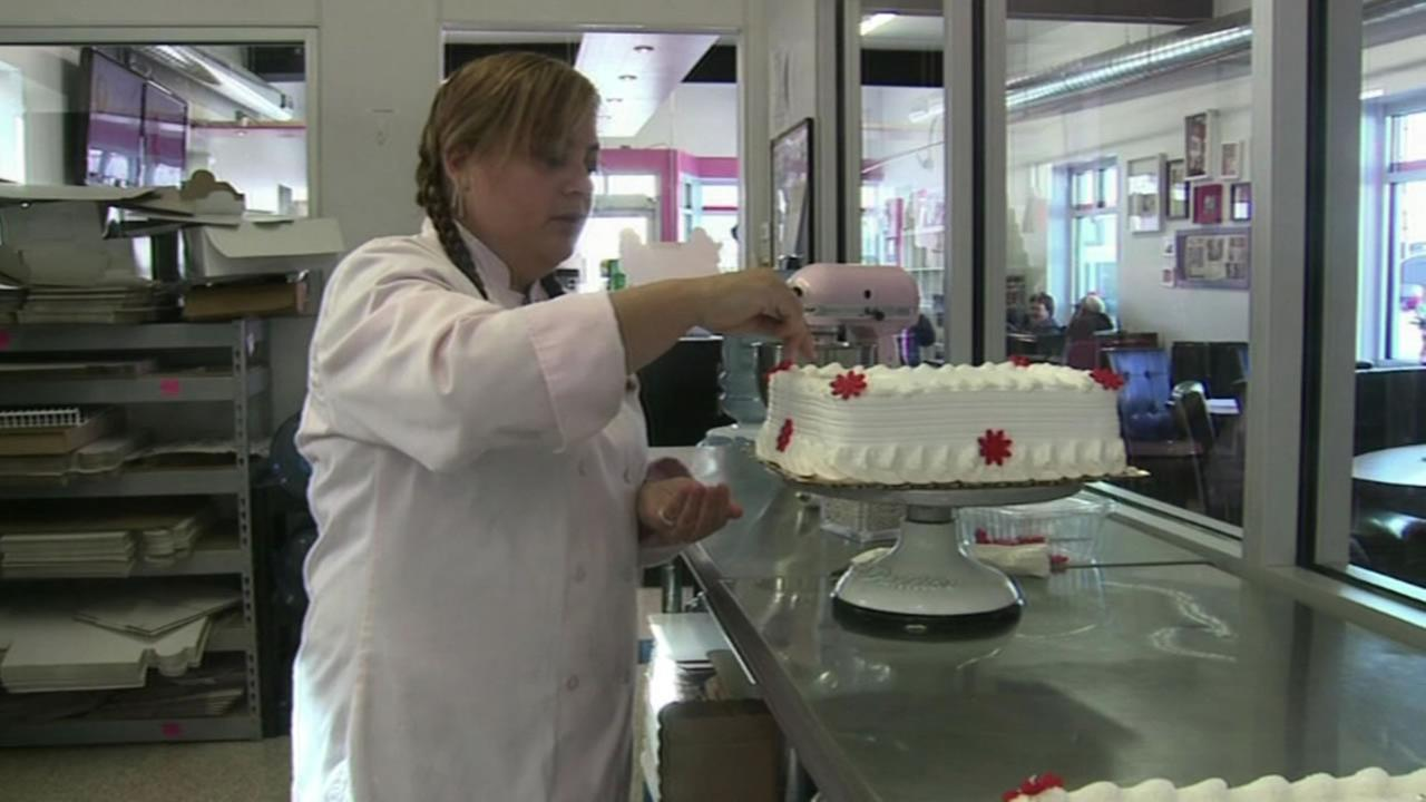 Woman decorates a cake