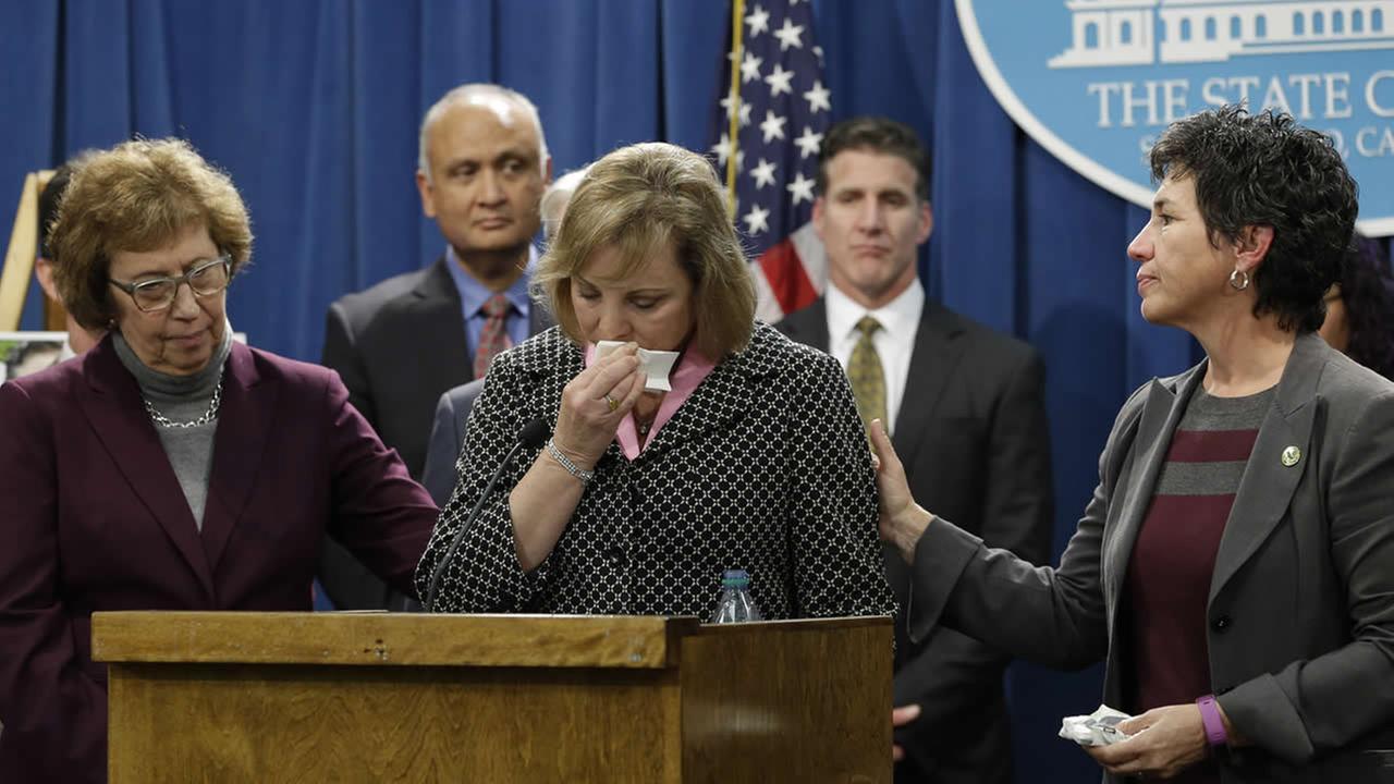 Debbie Ziegler is comforted by Sen. Lois Wolk, D-Davis, and Assemblymember Susan Talamantes Eggman, D-Stockton, during a news conference Jan. 21, 2015, in Sacramento, Calif. (AP Photo/Rich Pedroncelli)