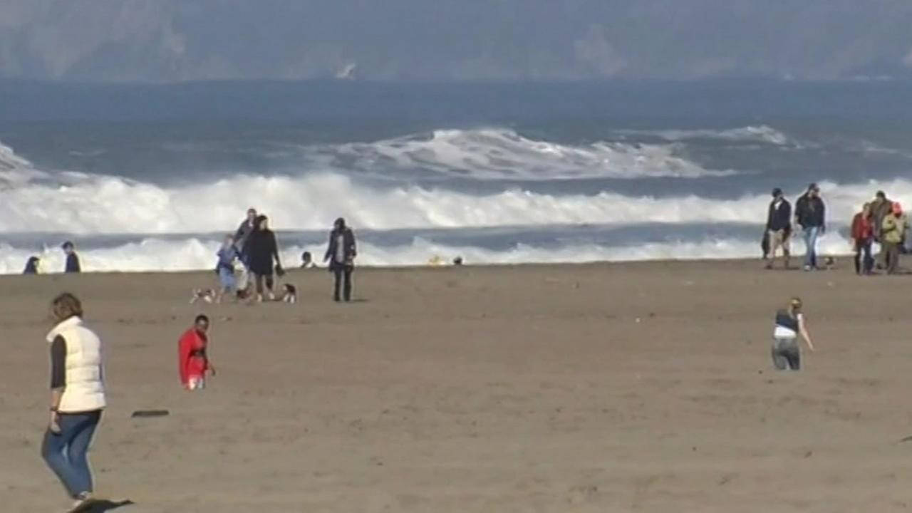 Bay Area residents enjoy warm weather at a local beach.