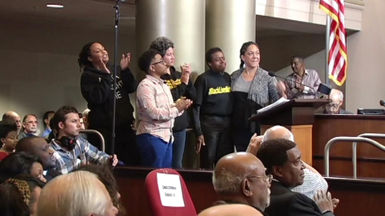 Demonstrators speak at a city council meeting in Oakland, Calif. on Saturday, Jan. 24, 2015.