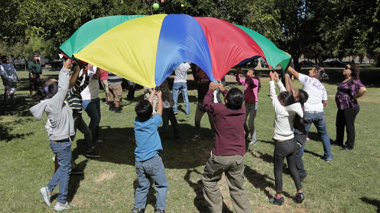 kids playing with a parachute
