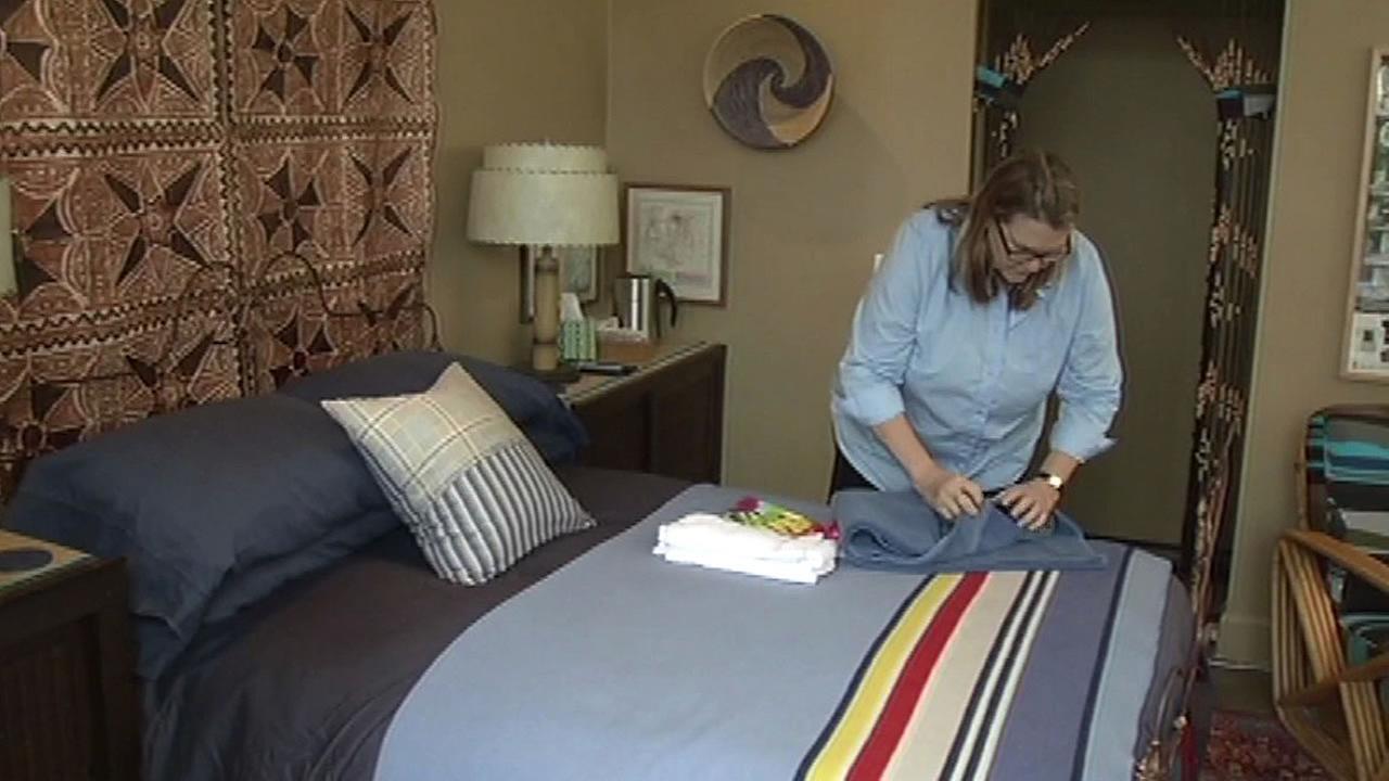 Airbnb host Kepa Askenasy folds towels