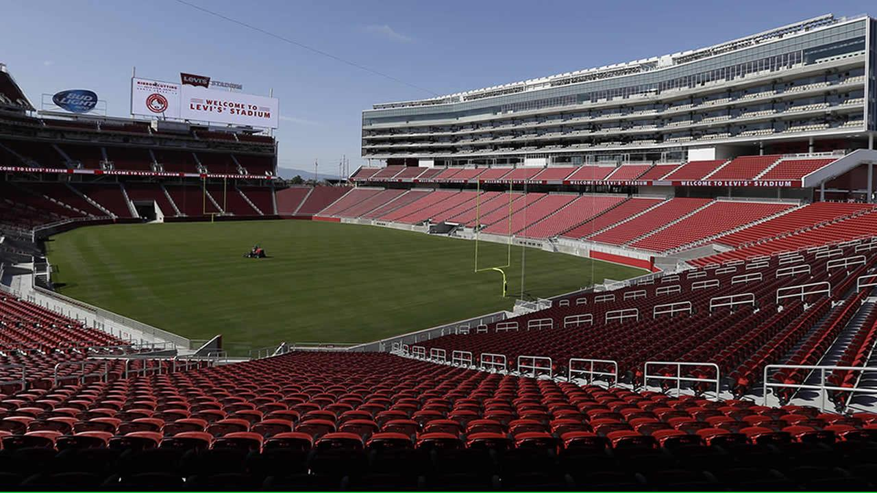 FILE - In this July 17, 2014, file photo, a groundskeeper drives across the field before the ribbon-cutting and opening of Levis Stadium, in Santa Clara, Calif. (AP Photo)