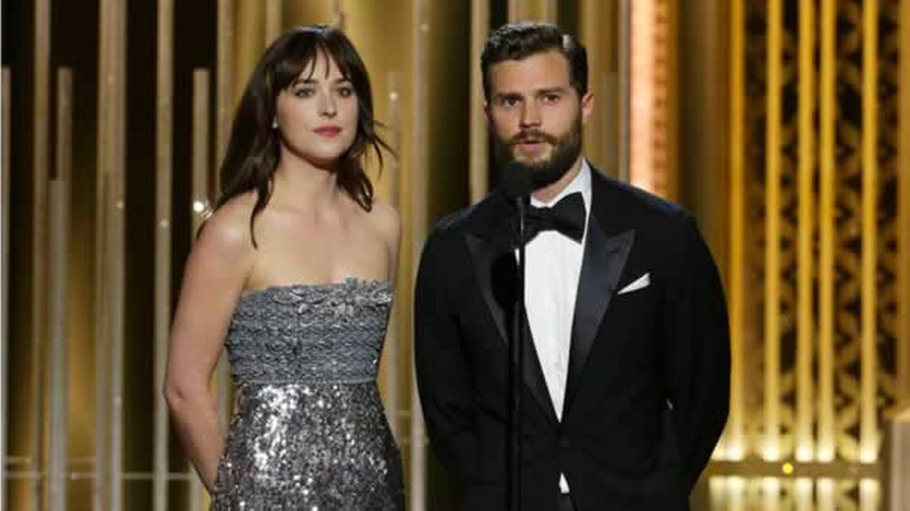 Fifty Shades of Grey starts Dakota Johnson, left, and Jamie Dornan present an award at the 72nd Annual Golden Globe Awards on Sunday, Jan. 11, 2015