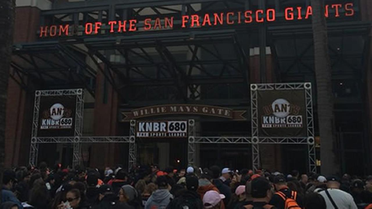 San Francisco Giants fans line up outside AT&T Park for Fanfest on Saturday February 7, 22015.