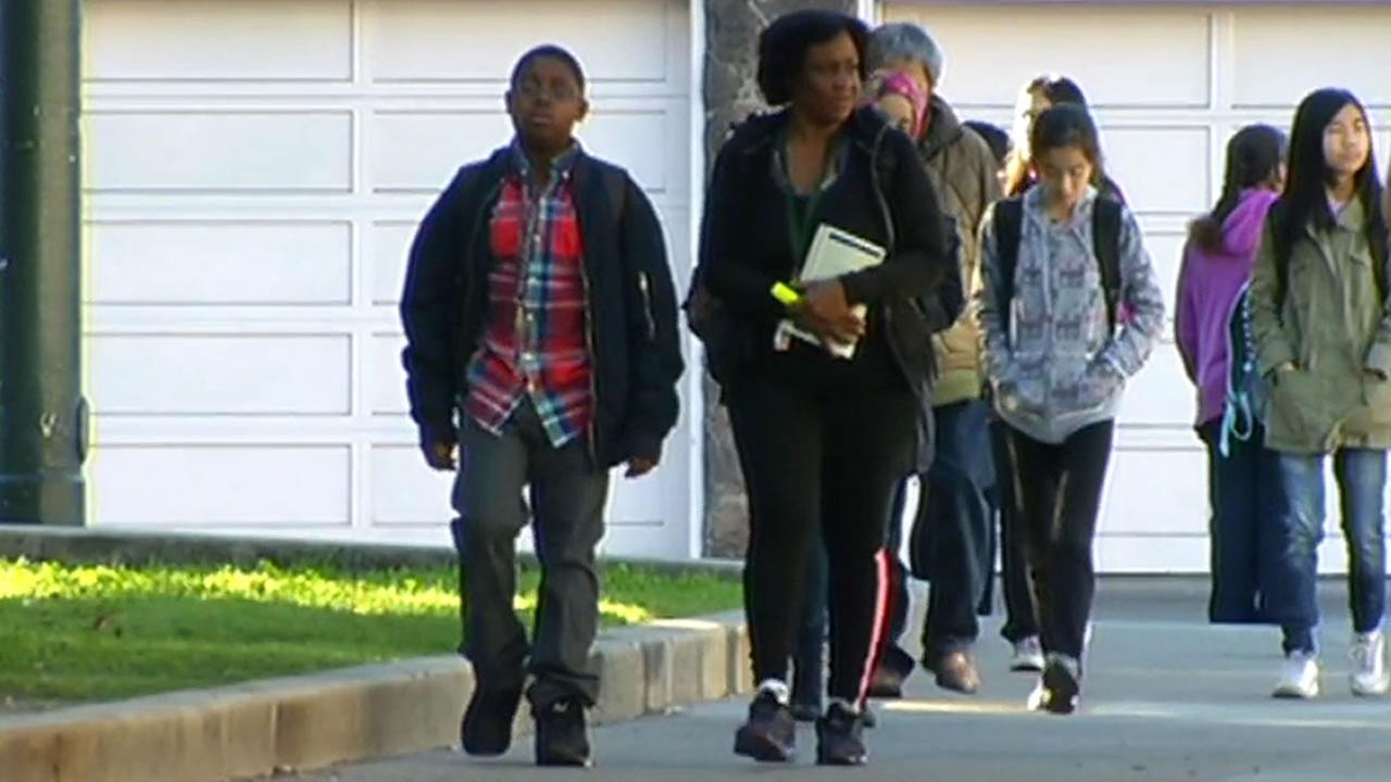 Parents and students walk to school in San Francisco on Feb. 16, 2015.