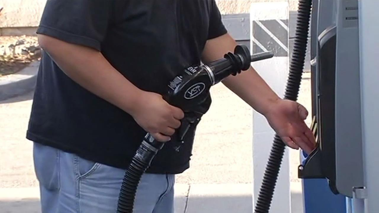 A man prepares to fill up his trucks tank at a gas station in San Jose, Calif. on Feb. 18, 2015.