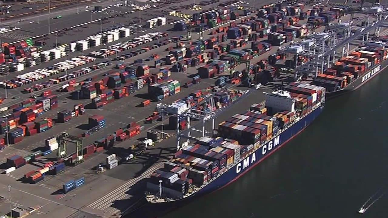 Shipping containers sit at Port of Oakland