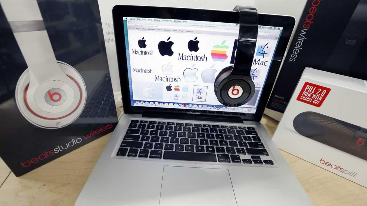 Beats Audio equipment is arranged for a photo next to an Apple laptop at Best Buy in Boston, Friday, May 9, 2014.