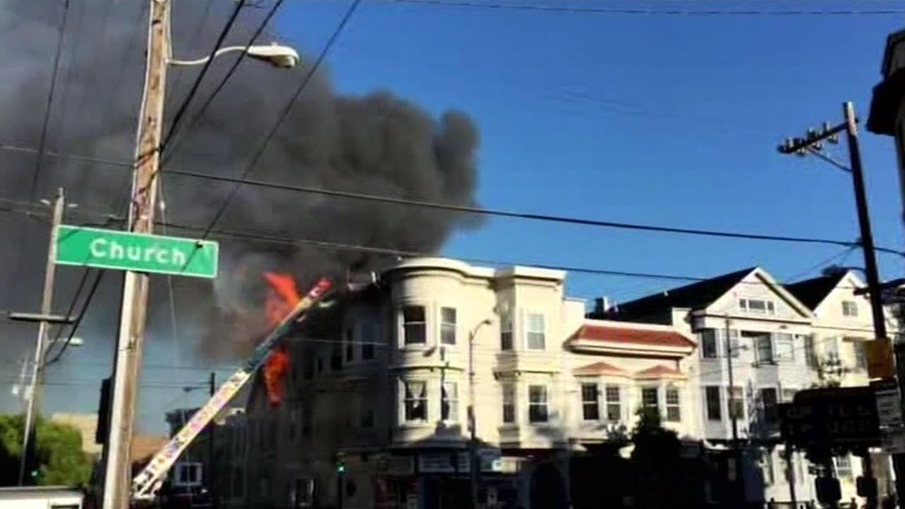 Video from Mission District resident Roberto Cozenza shows flames from a fire that burned two buildings and damaged a third in San Francisco on Feb. 21, 2015.