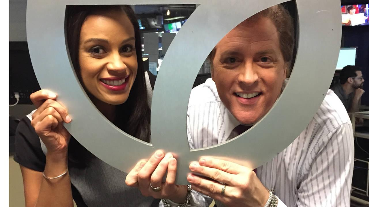 ABC7 News Anchors Dan Ashley and Ama Daetz pose for a photo to show off their Super Bowl 50 spirit.