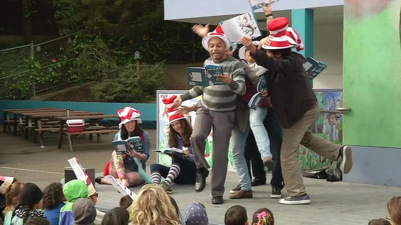 Spencer and actors read to children for Read Across America Day