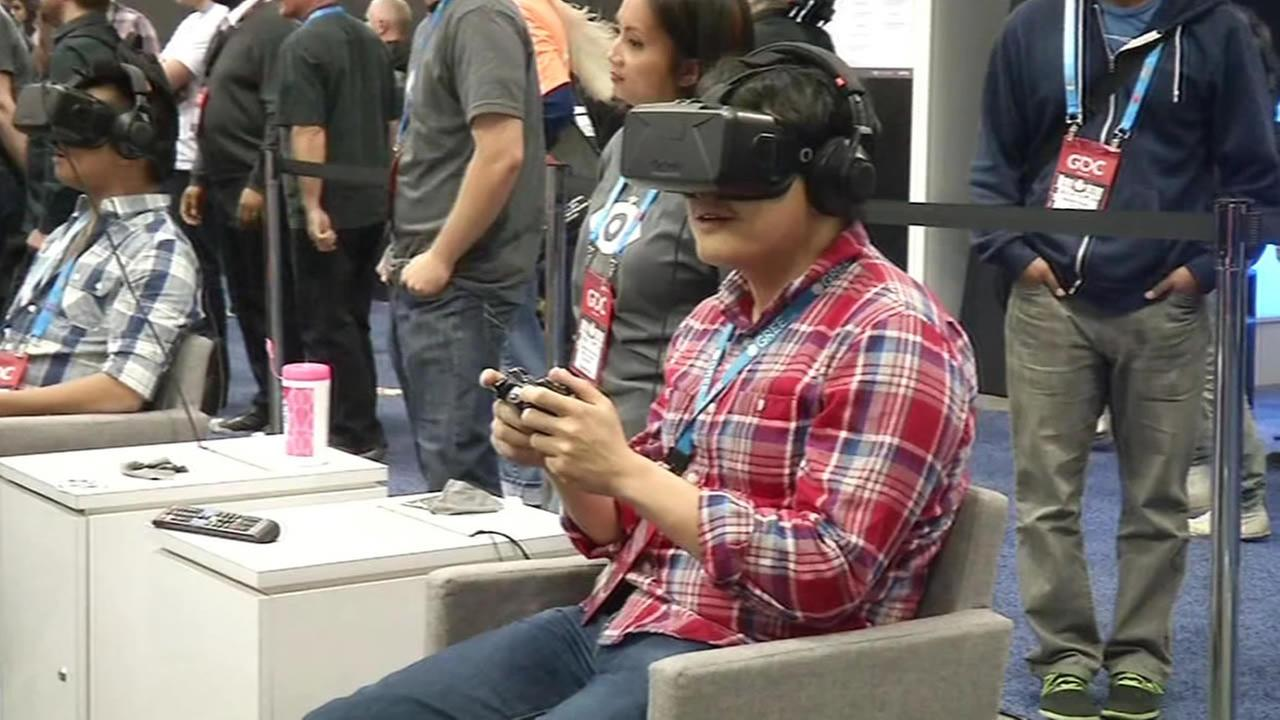 man playing a video game with a headset