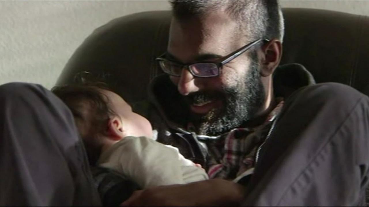 Stanford neurosurgeon Paul Kalanithi holds his daughter Katie
