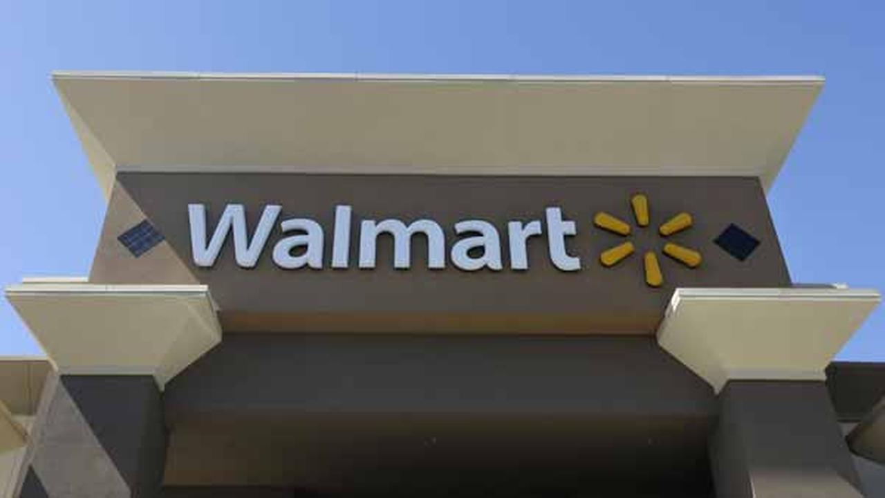 This Sept. 19, 2013 photo shows the sign of a Walmart store in San Jose, Calif. (AP Photo/Jeff Chiu)