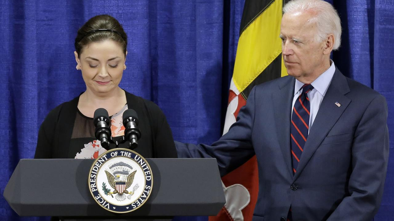 Vice President Joe Biden comforts sexual assault victims advocate Helena Lazaro as she pauses while recalling her experience as a victim of rape, Monday, March 16, 2015. (AP Photo)
