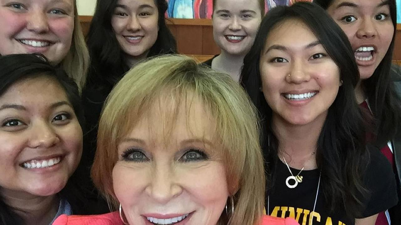 ABC7 News anchor Cheryl Jennings takes a selfie with young women involved in the Enlighten mentoring event in Marin City on Saturday, March 21, 2015.