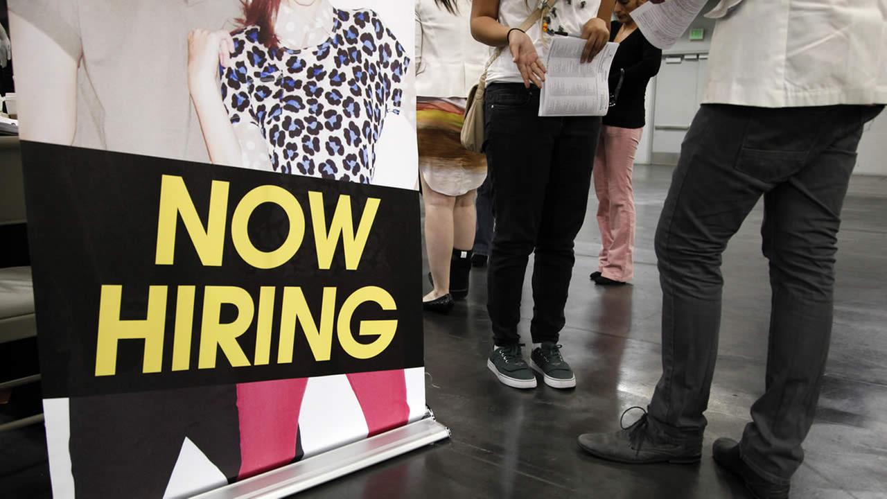 In this June 13, 2012, file photo, a job seeker talks to a recruiter at a job fair expo in Anaheim, Calif.  (AP Photo/Jae C. Hong, File)