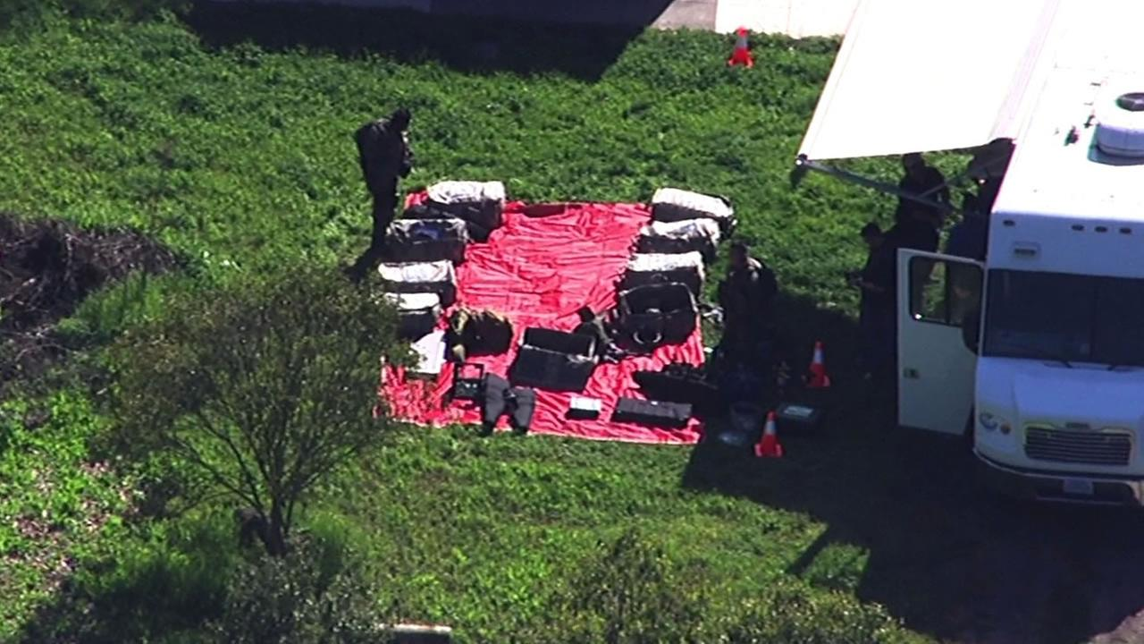 Police have surrounded a Palo Alto home after a burglary suspect barricaded himself inside March 23, 2015.