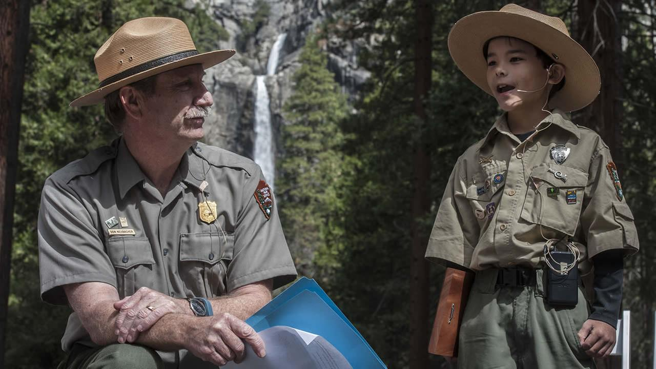 Yosemite National Park Superintendent Don Neubacher talks with Honorary Ranger Gabriel Lavan-Ying in Yosemite National Park, Calif. on March 24, 2015.