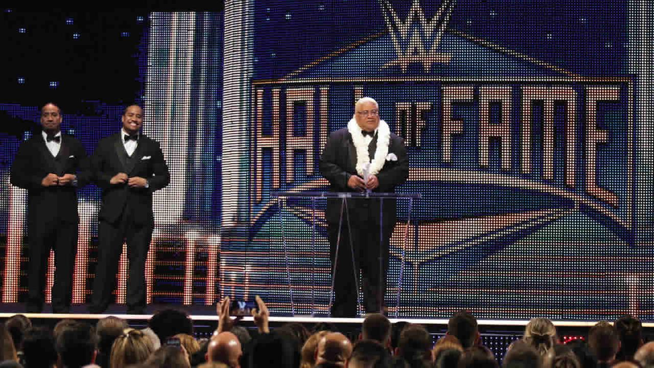 Inductee Rikishi accepts his award with his sons, Jimmy and Jey Uso at the WWE Hall of Fame Ceremony, on Saturday, March 28, 2015 in San Jose, Calif. (Don Feria/AP Images for WWE)