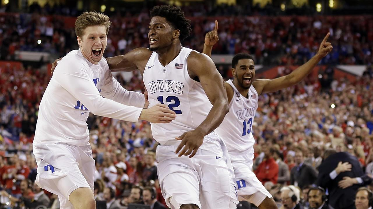 Duke players celebrate after the NCAA Final Four college basketball tournament